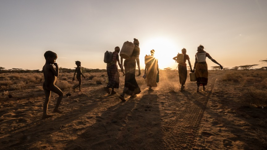 Families head home after fetching water from a borehole in drought-prone northern Kenya.